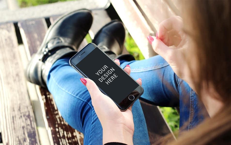 Lady using iPhone Mockup