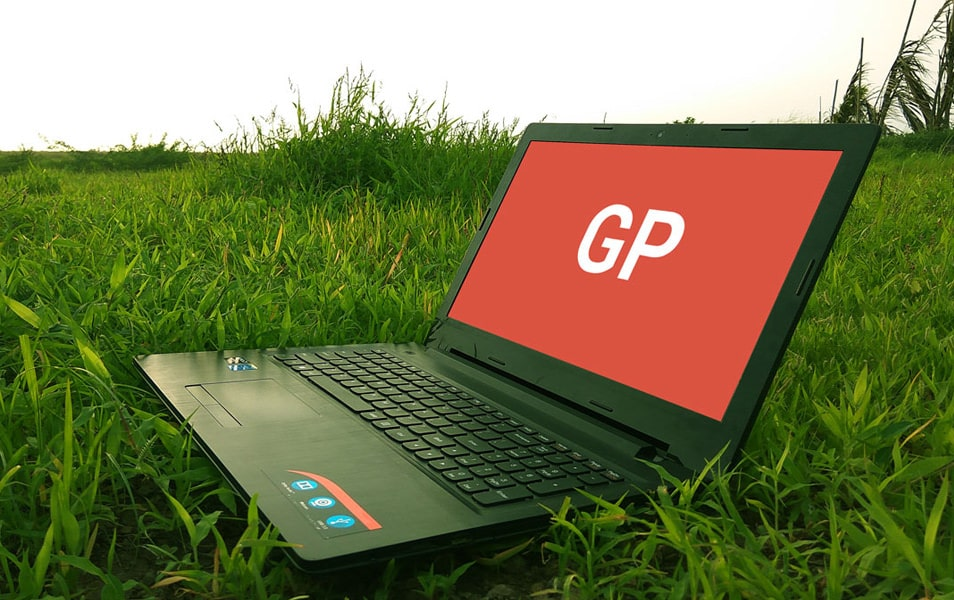 Laptop on Grass Mockup